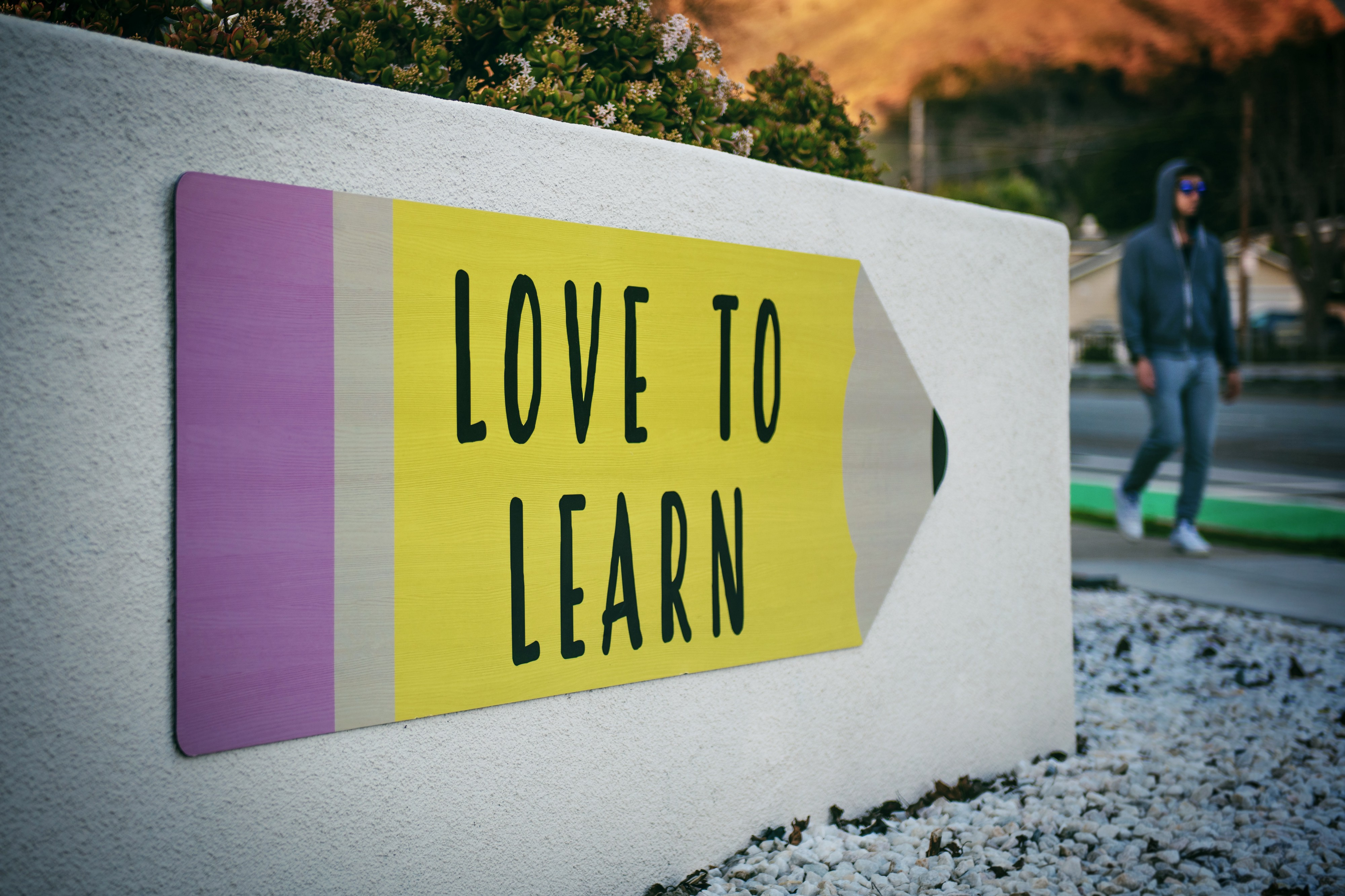 love to learn written on a giant pencil outdoor sign
