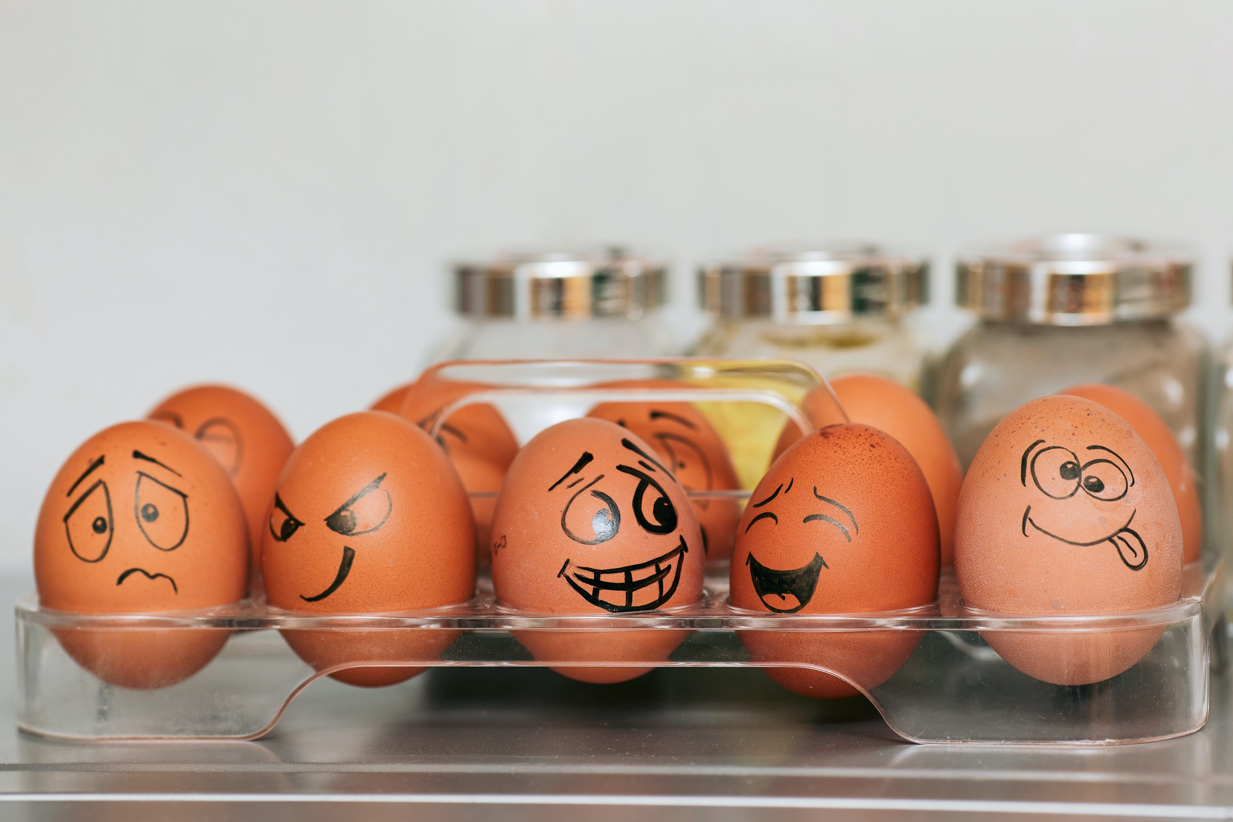 eggs with different facial expressions drawn on